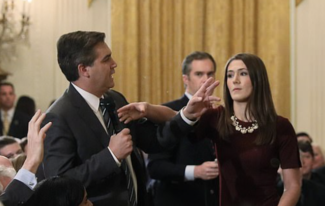 White House blasts 'grandstanding' CNN for lawsuit demanding Jim Acosta get back his press credentials after he was banned for clashing with female intern over press conference microphone