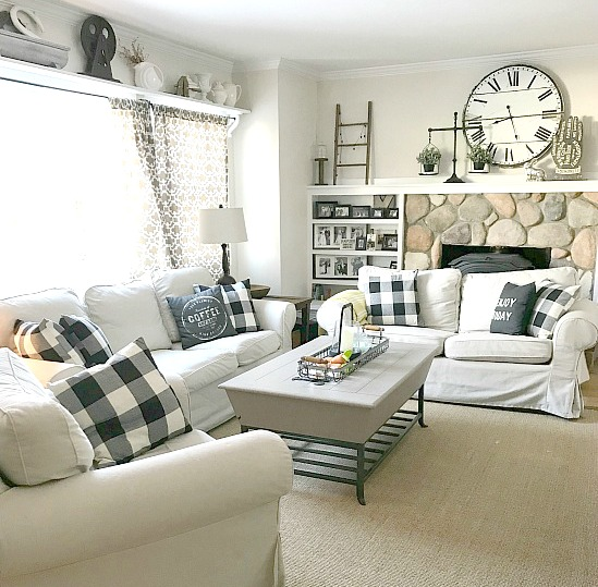 Farmhouse Style living room with white couches and buffalo check