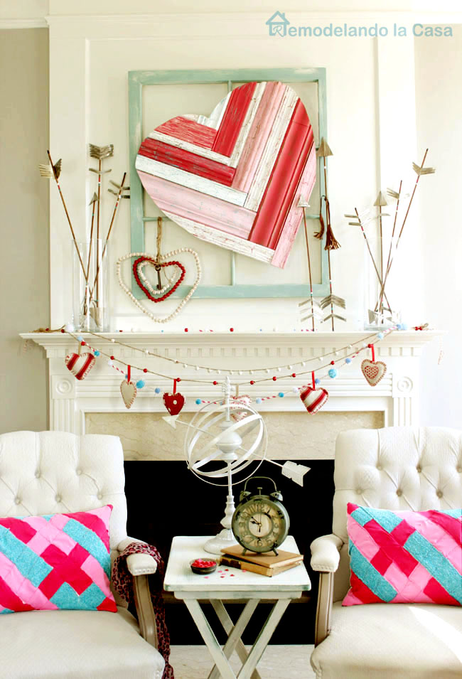 rustic arrows, big molding heart art and lots of hearts mantel