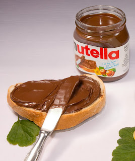 Photo of Nutella and bread spread with Nutella