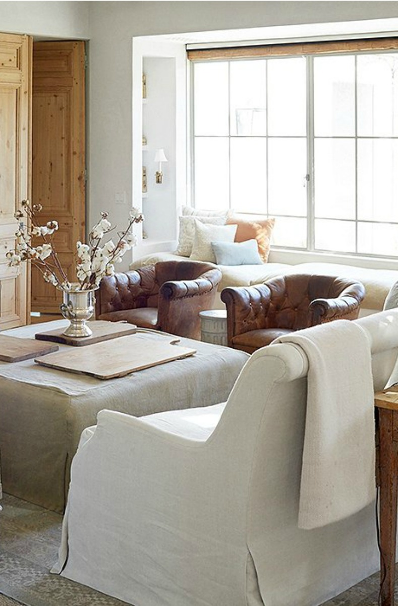 Leather club chairs and #Belgianlinen furniture in #modernfarmhouse living room at #PatinaFarm