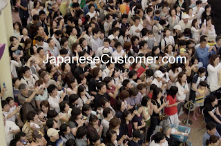 Japanese customers at shopping centre copyright peter hanami 2013