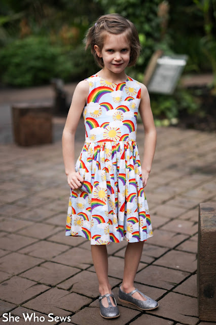 Girl in rainbow dress with silver shoes