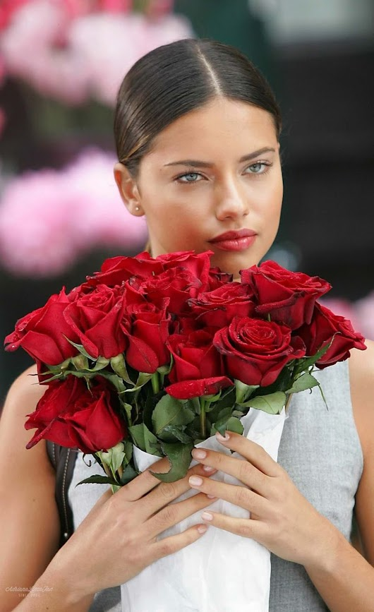 ADRIANA LIMA WITH ROSES