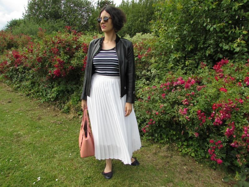 White maxi pleated skirt and biker jacket