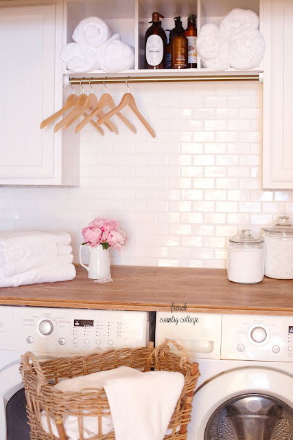 White subway tile, butcher block countertop, laundry room closet renovation reveal