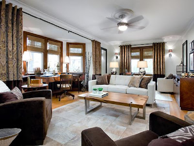 Cream, brown and tan - Cream walls, rug, sofa, Brown chairs and Tan hardwood, blinds, coffee table