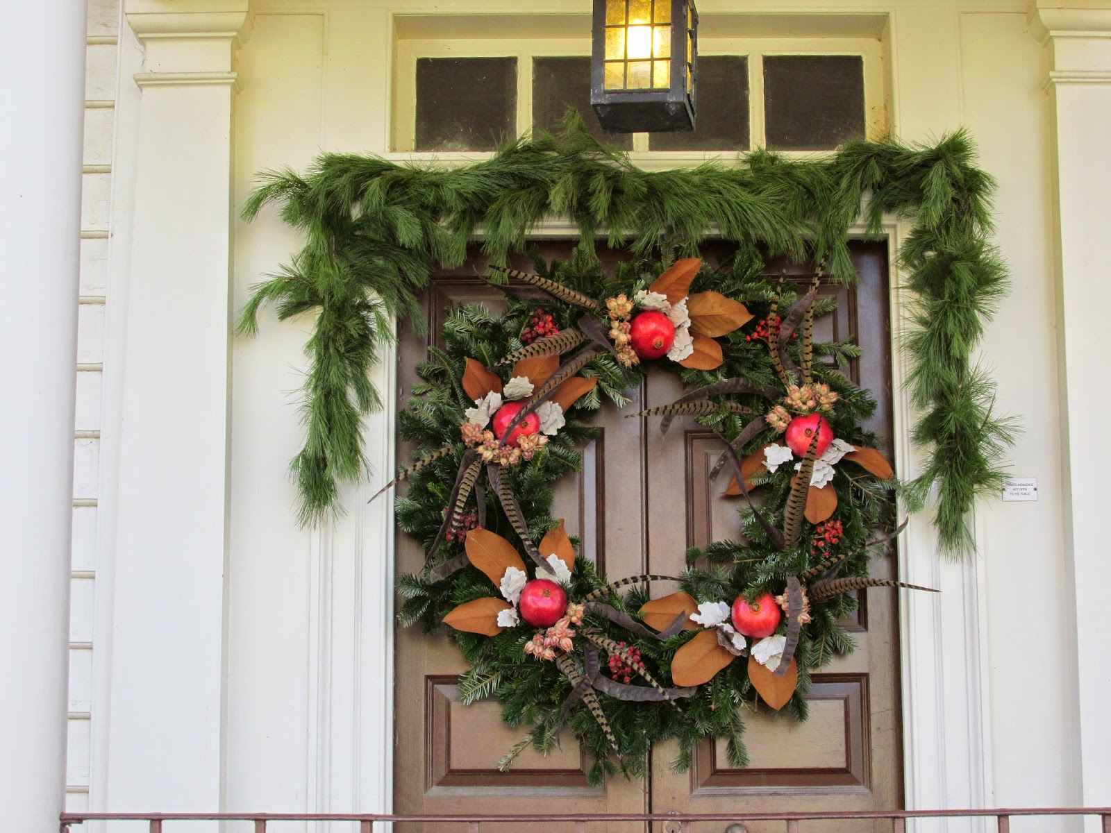 this beautiful wreath caught my eye i couldnt help but wonder if the gentleman of the house had recently been pheasant hunting - Colonial Williamsburg Christmas Decorations