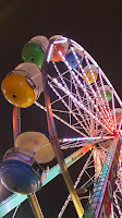 brightly lit ferris wheel against the night sky
