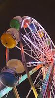 brightly lit ferris wheel against the night sky