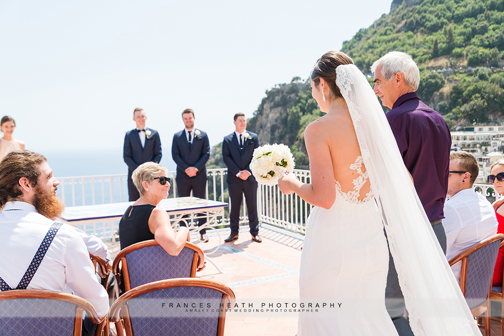 Bride walking down aisle Positano town hall