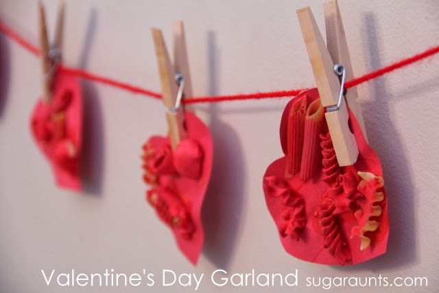 Create a Valentine's Day heart garland for decoration and fine motor/sensory experience.