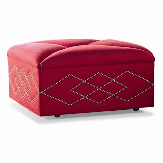 modern red ottoman with argyle nail trim