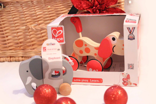 pull along wooden toys dog and elephant from hape - toddler Christmas gift ideas