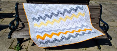 http://www.sewmotion.com/sewmotion_shop/prod_4634796-Monochrome-Sunset-Zig-Zag-Quilt-Kit-in-Riley-Blakes-Dot-Dash-and-Kona-Solids.html