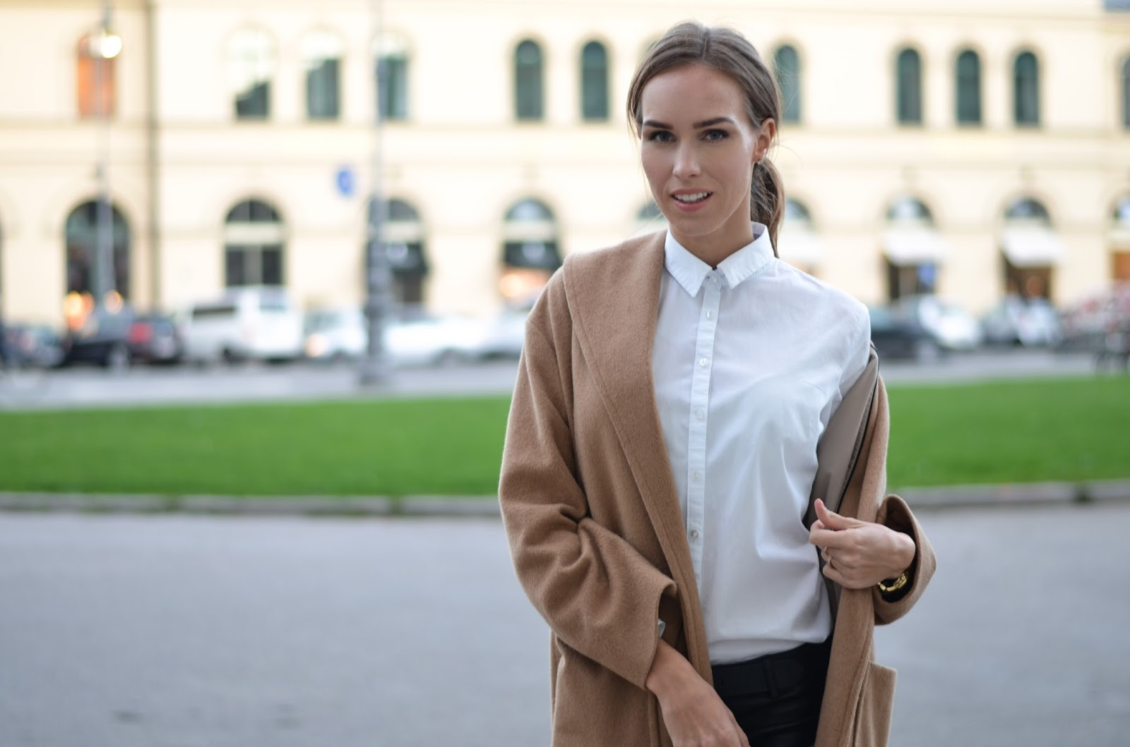 kristjaana mere camel coat white button down shirt minimalist fall winter fashion