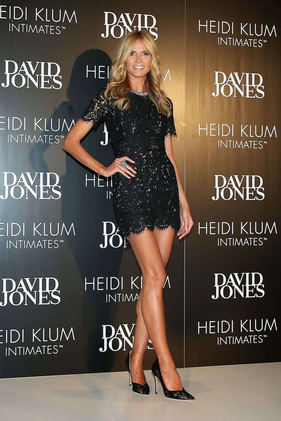 Heidi Klum wears a lace mini dress at the launch of HK Intimates in Sydney