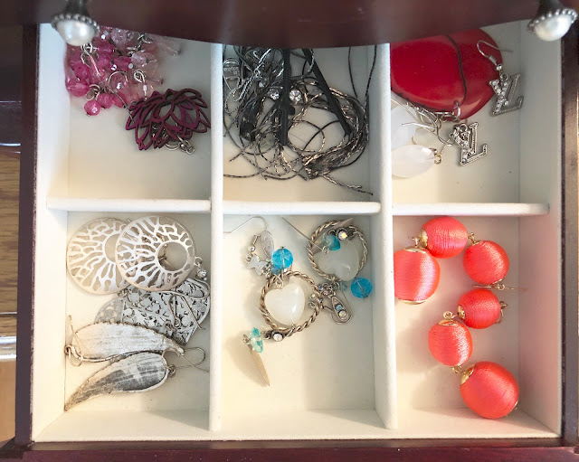 earrings in organized jewelry box