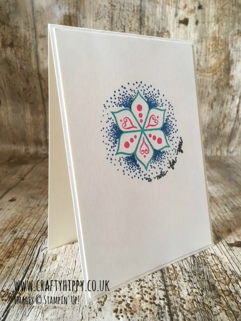 This image shows a white handmade card with a Mandala style image in the middle, made with the Eastern Beauty stamp set from Stampin' Up! and stamped in Pacific Point, Melon Mambo and Bermuda Bay