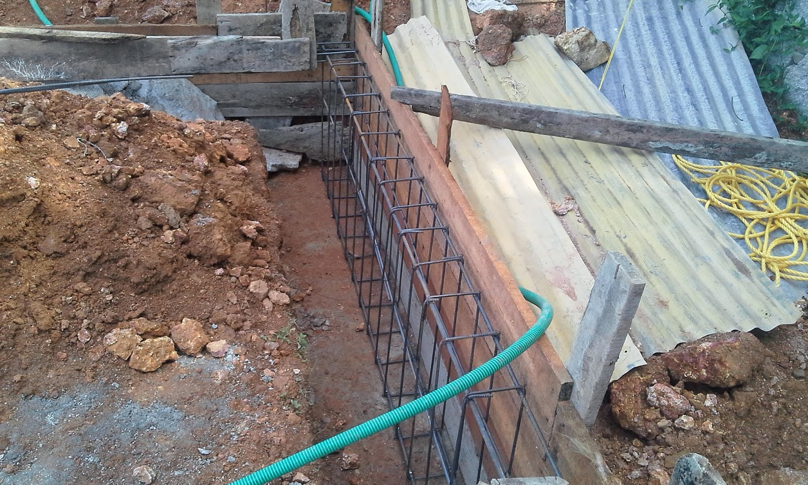 Kerala house construction tips 4 belt concrete for Basement foundation construction