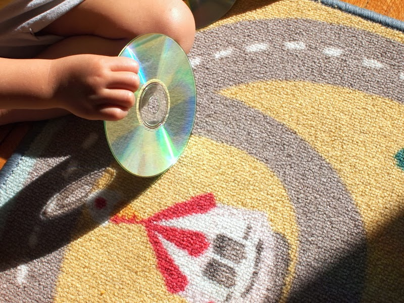 Reflecting sunshine to make a rainbow off a CD