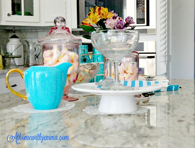 retro champagne glasses, white cake stand, turquoise creamer, hosting a party