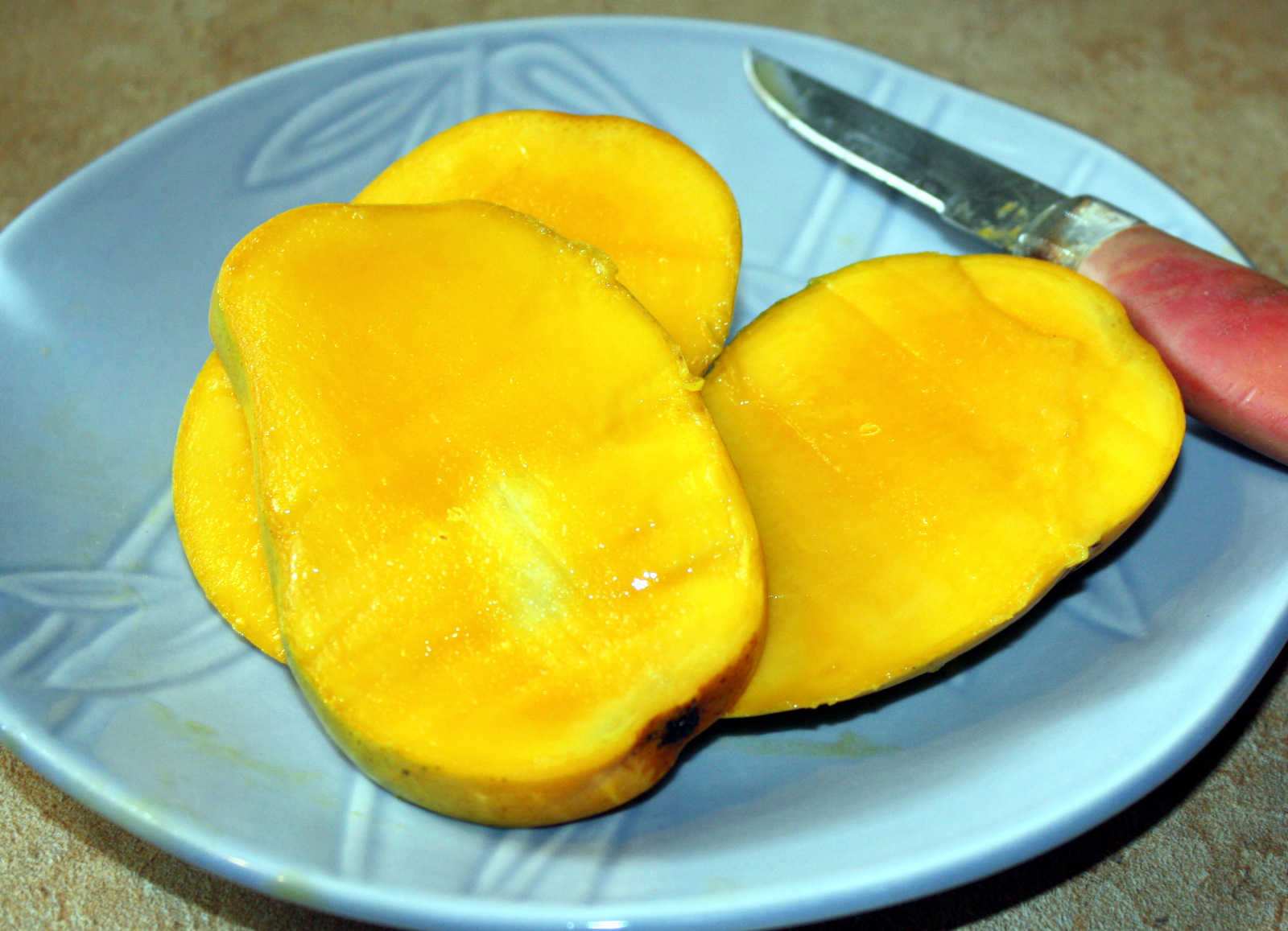 Mango smoothie manila spoon then cut lengthwise and then crosswise across the flesh down to the skin they call this the hedgehog style of cutting a mango see below ccuart Choice Image