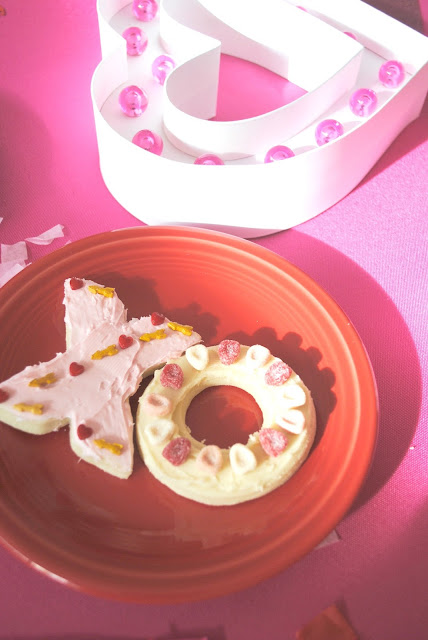Throw a Galentine's Cookie Decorating party. For inspiration pop over to www.fizzyparty.com