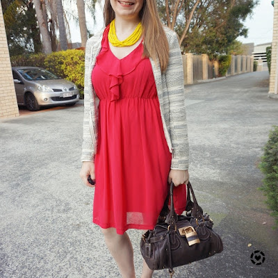 awayfromblue instagram pink ruffle dress with yellow statement necklace business casual office wear spring