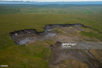 A massive permafrost thaw slump near the Arctic Ocean coastline. Qikiqtaruk, Herschel Island, Yukon, Canada. (Credit: gettyimages.com) Click to Enlarge.