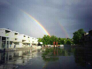 tormenta de verano y arco iris