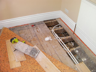 radiator pipes under floorboards