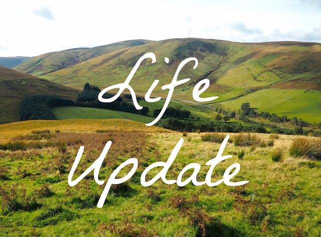 'Life Update' text on green farm hills background
