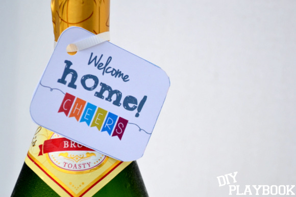 Secure the card around the neck of the bottle and place in the fridge for a surprise gift