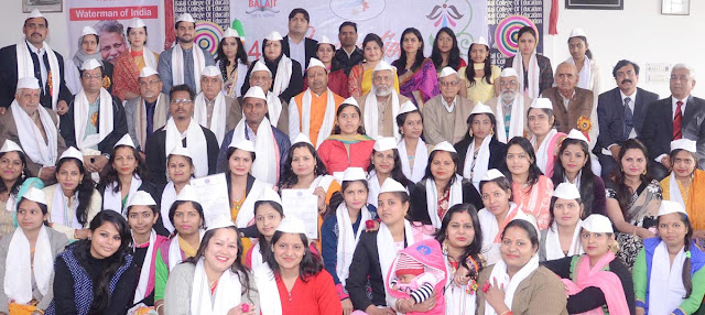Students take the degree of degree by putting white cap in the convocation ceremony at Balaji College