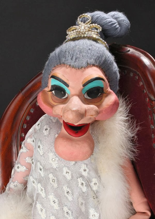 Madame the puppet on solid gold