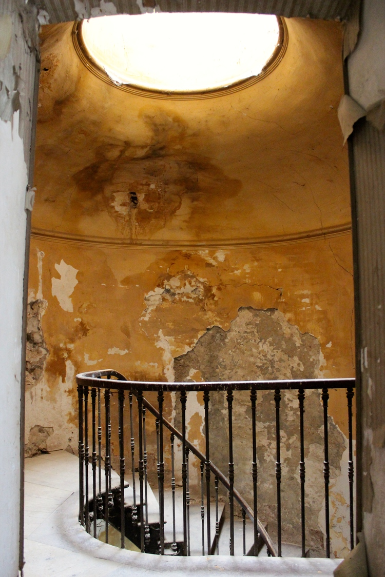 Mustard wall color in stairway of French Chateau de Gudanes. Weathered Walls & Déshabillé Lovely. #walls #distressed #staircase #chateau #French #oldworld