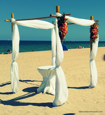 Beach wedding bamboo gazebo and flowers
