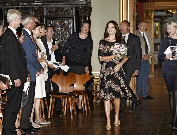 Crown Princess Mary wore Dolce & Gabbana Floral Panel Dress, Naledi Copenhagen Allana Latte Ostrich Clutch, photographer Marco Grop
