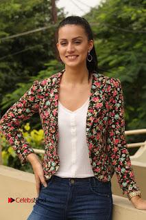 Actress Larissa Bonesi Stills in Ripped Jeans at Thikka Press Meet  0218