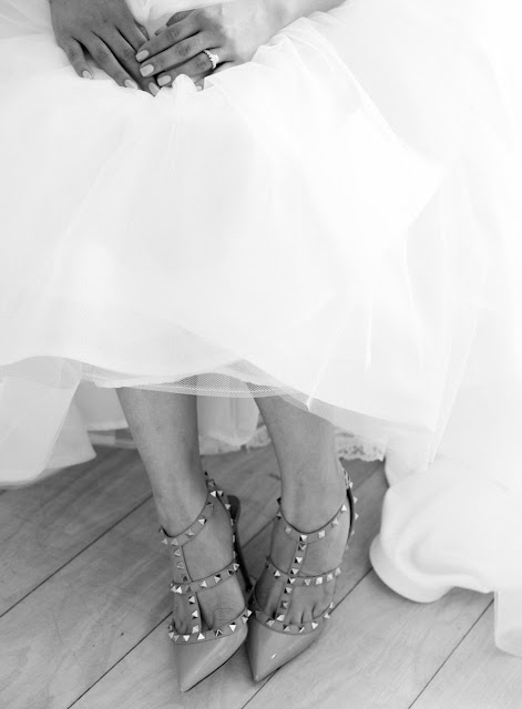 Jin shows off her modern, funky heels before her Bridgeview Yacht Club wedding