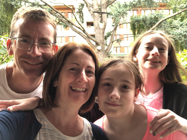 Family selfie in front of Disney hotel
