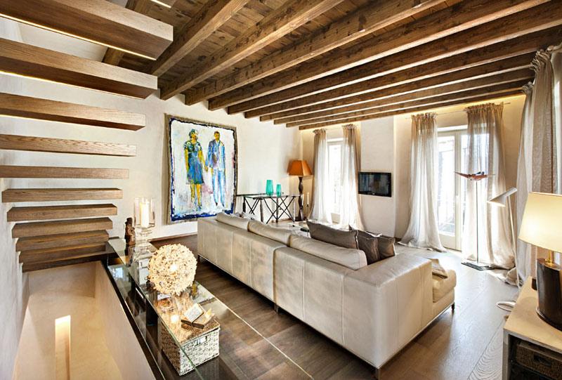 Heteruf designs: casa con decoración en mezcla de diseños rústico y