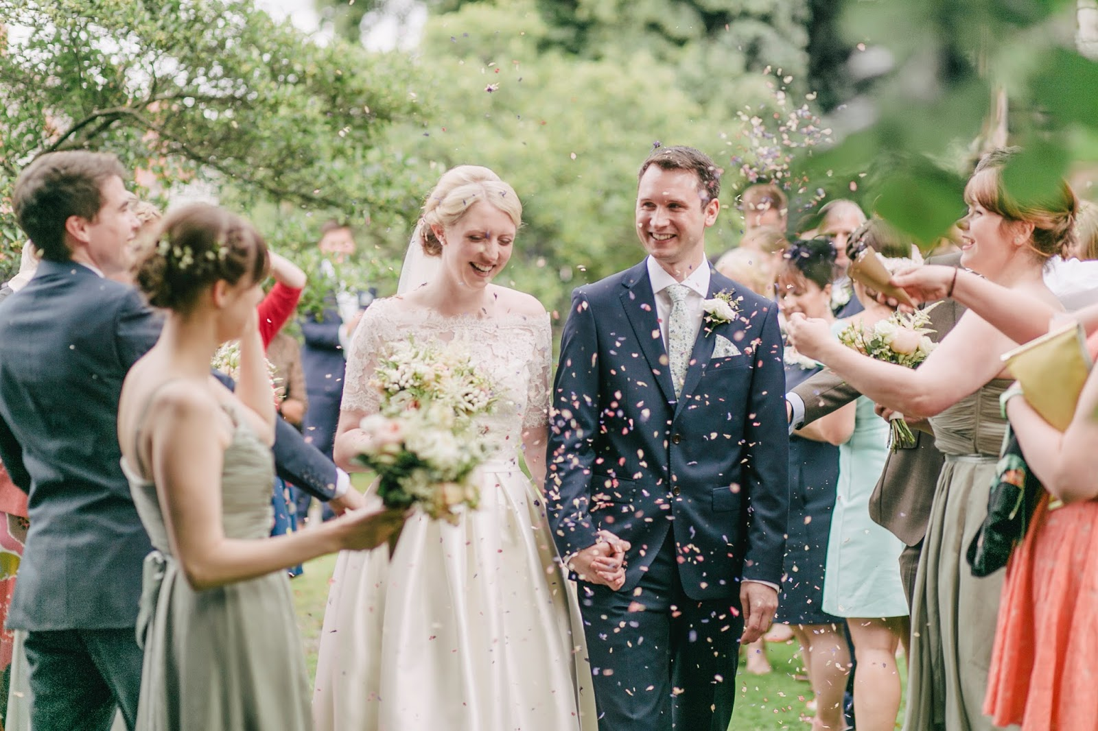 Bride & groom leaving their ceremony with guests throwing confetti
