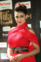 Apoorva in a Stunning Tight Leg Split Sleeveless Red Gown at IIFA Utsavam Awards 29.JPG