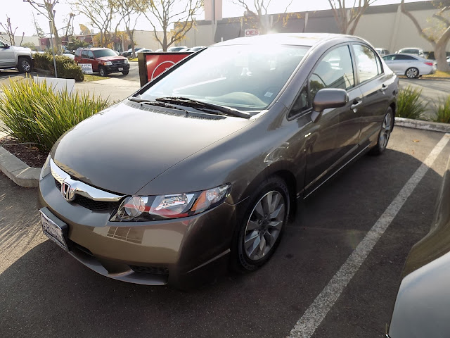 Honda Civic with damaged hood, bumper & fender after repairs at Almost Everything Auto Body.