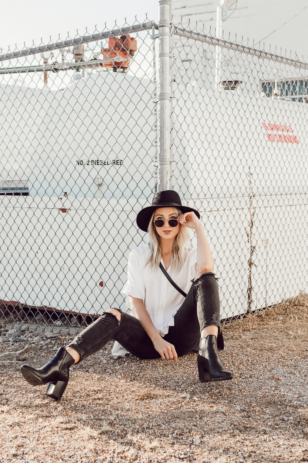 Ripped jeans, small sunglasses, wide brim hat   Love, Lenore