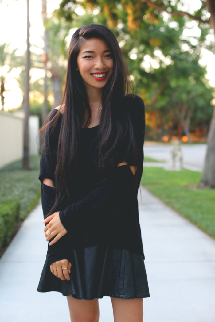 Stephanie Liu of Honey & Silk shares 3 ways to style red heels. The last look is an all-black mood in a Honey Punch shirt, Greylin leather skirt, Kitsch jewelry, and Kelsi Dagger Blanca heels