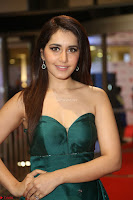 Raashi Khanna in Dark Green Sleeveless Strapless Deep neck Gown at 64th Jio Filmfare Awards South ~  Exclusive 141.JPG