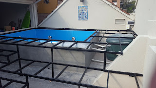 Pool deck supporting metal frame